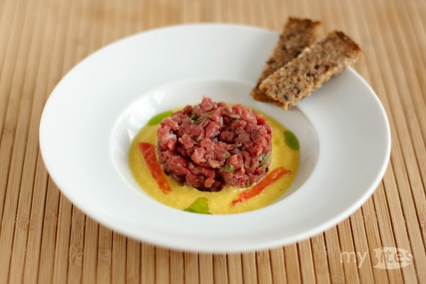 Steak Tartare with Bell Pepper Coulis, Mustard Tomato, Dill Oil and Linseed Bread