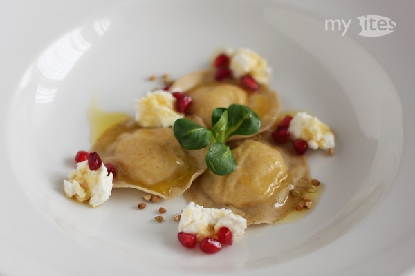 Buckwheat-Celery Ravioli with Goat Cheese, Chestnut Honey, Pomegranate and Orange Butter
