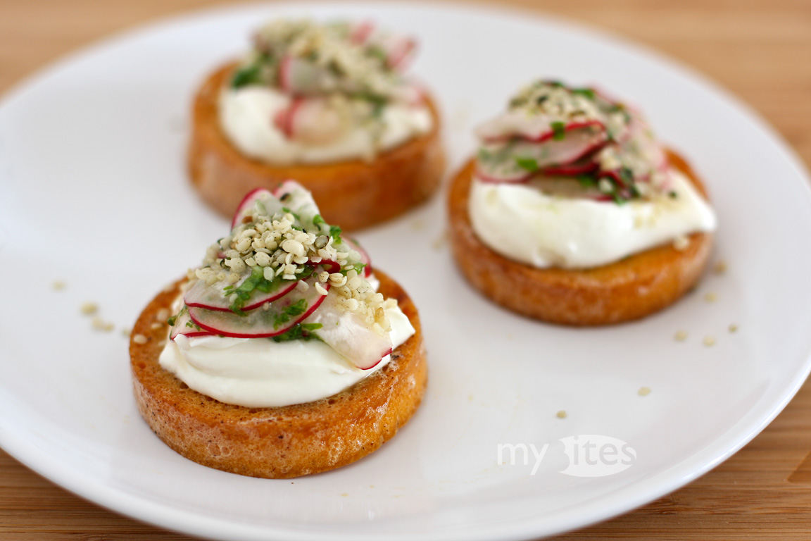 "Egg Yolk ""Bread"" with Goat Cheese, Marinated Radish and Hemp Seeds"